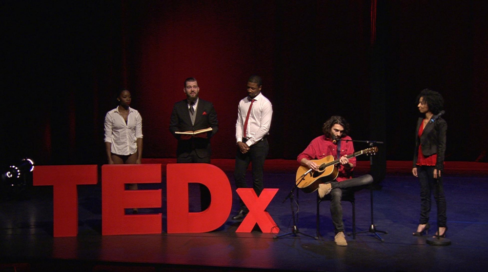 Playing guitar at a TEDx cross-arts performance, Oude Luxor Theater Rotterdam