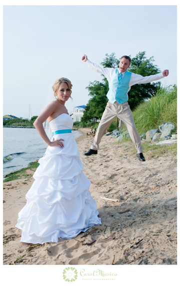 Katie and Matt having fun on the beach after their wedding at the Chesapeake Bay Beach Club