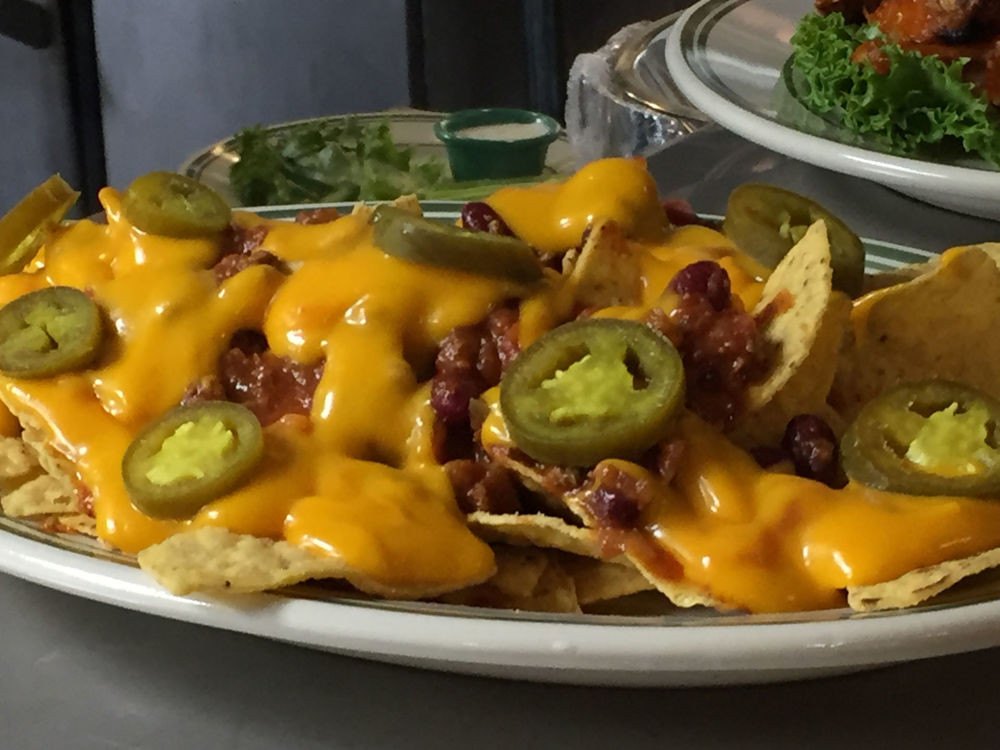 Enjoy some nachos as you watch the game at the bar.