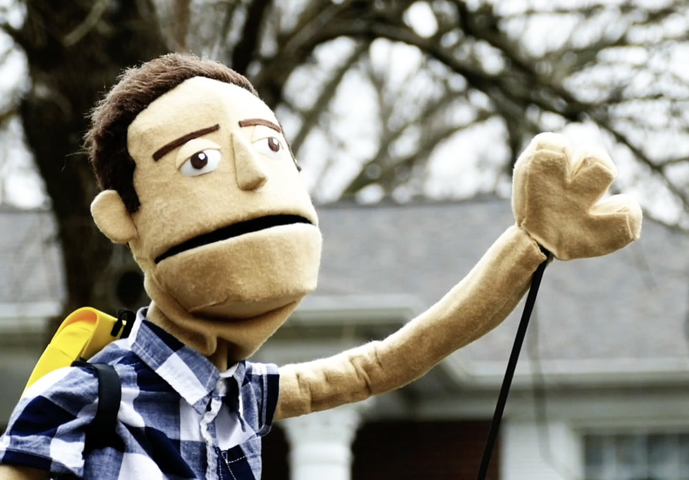 """Puppet Ian"" as seen in the camp promotional pieces."