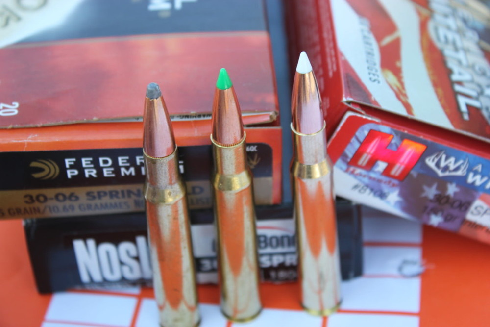 These are all .30-06 cartridges, but their bullets are quite different. On the left is a lead-nosed bullet with a jacket, a great choice for a variety of game. The two polymer-tipped bullets on the right have a higher ballistic coefficient and will fly flatter and do a better job bucking the wind. The Nosler load on the right has a 180-grain bullet, which has the highest sectional density and will likely penetrate better.