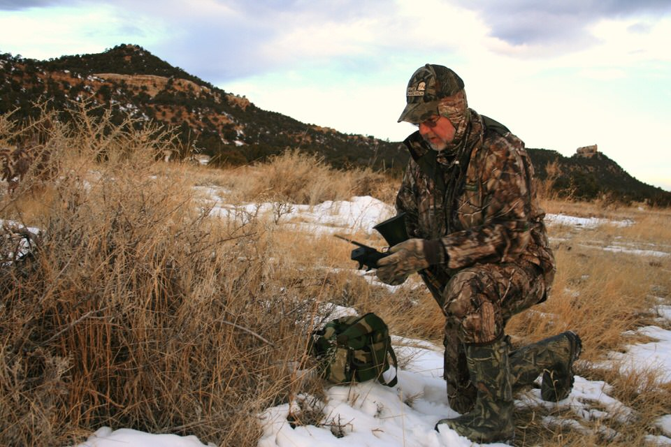 hunter-wearing-layers-to-stay-warm-while-coyote-hunting.jpg