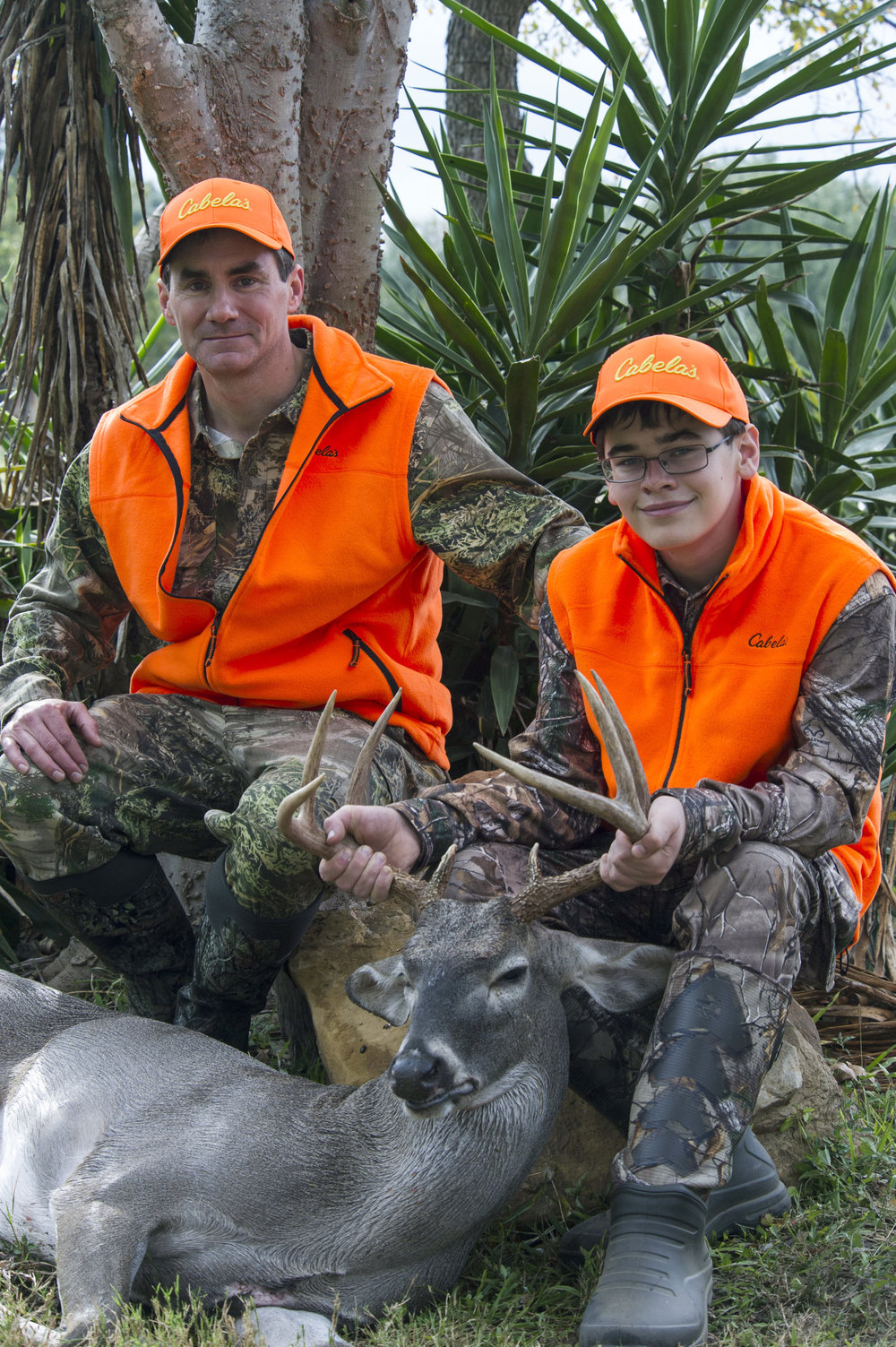 """- Paul and Michael Fraley from Houghton, MI, enjoyed the South Texas weather and were elated with Michael taking his first deer, a nice buck. Paul said, """"Hunting in the Upper Peninsula, Michigan, is way different than what we have experienced here!"""" Michael added, """"Yeah—I'm sure glad I was selected!"""""""