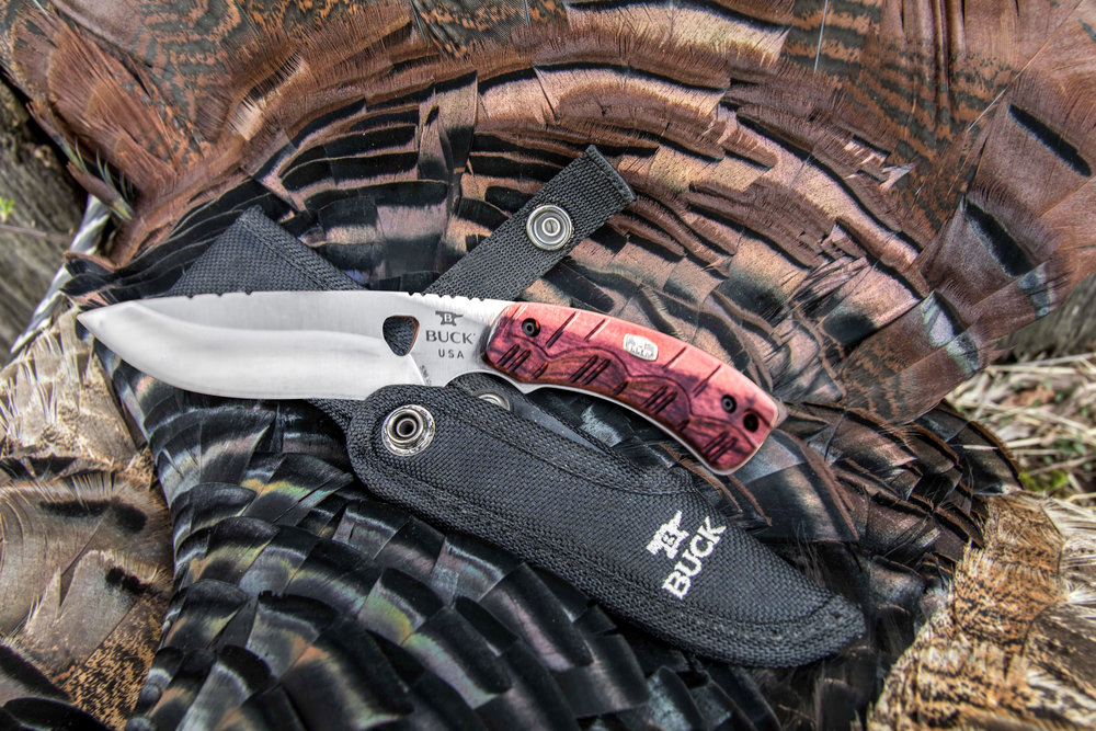 Buck Knives - OPEN SEASON SERIES 556 Folding Skinner  Made from quality materials, the Open Season Series is a combination of the best tools necessary for a successful hunting season. This series includes a Skinner, Small Game, and Folding Skinner which covers just about any animal and all game processing.  Offered in 420HC with a contoured red wood handle, the Open Season Series is a right fit for the serious hunter or beginners. Each knife comes with its own sheath and is covered by Buck's famous Forever Warranty.