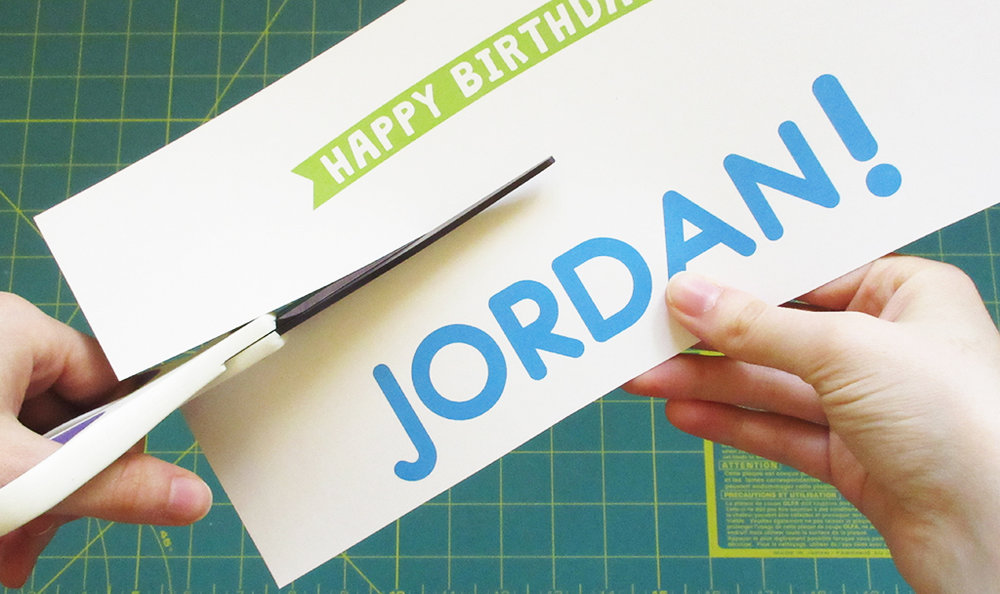 Cutting out DIY Streamer Name Cake Topper Template