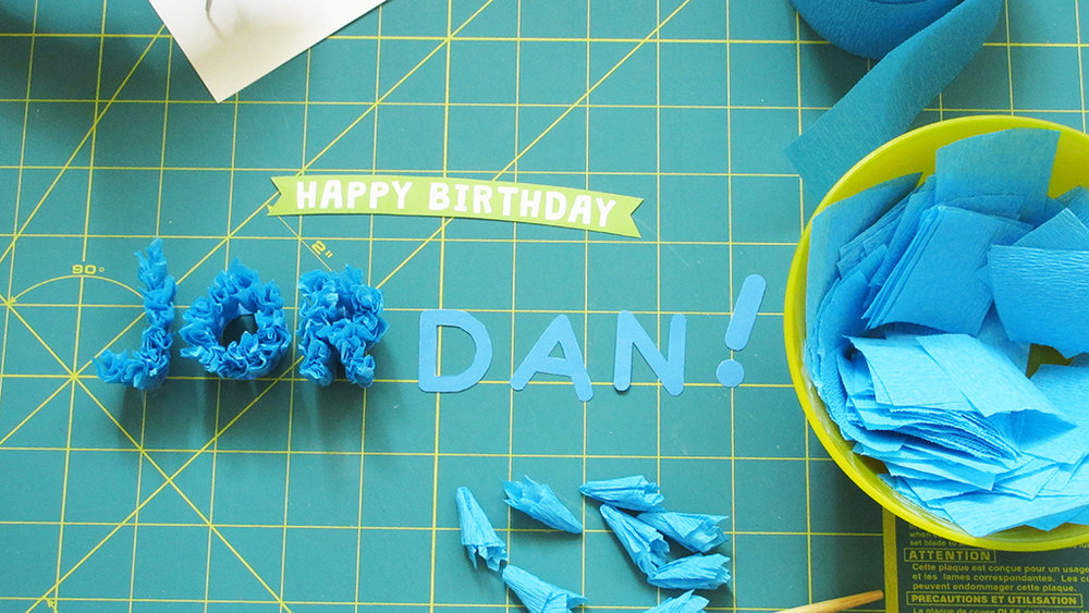 Three letters are finished of the DIY Streamer Name Cake Topper
