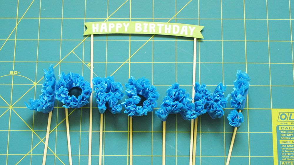 All the DIY Streamer Name Cake Topper letters are finished with skewers hot glued to the back, ready to be placed into a cake