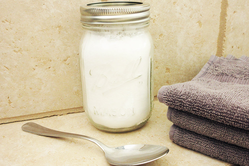 DIY Detox Bath Salt Blend sitting on counter with spoon