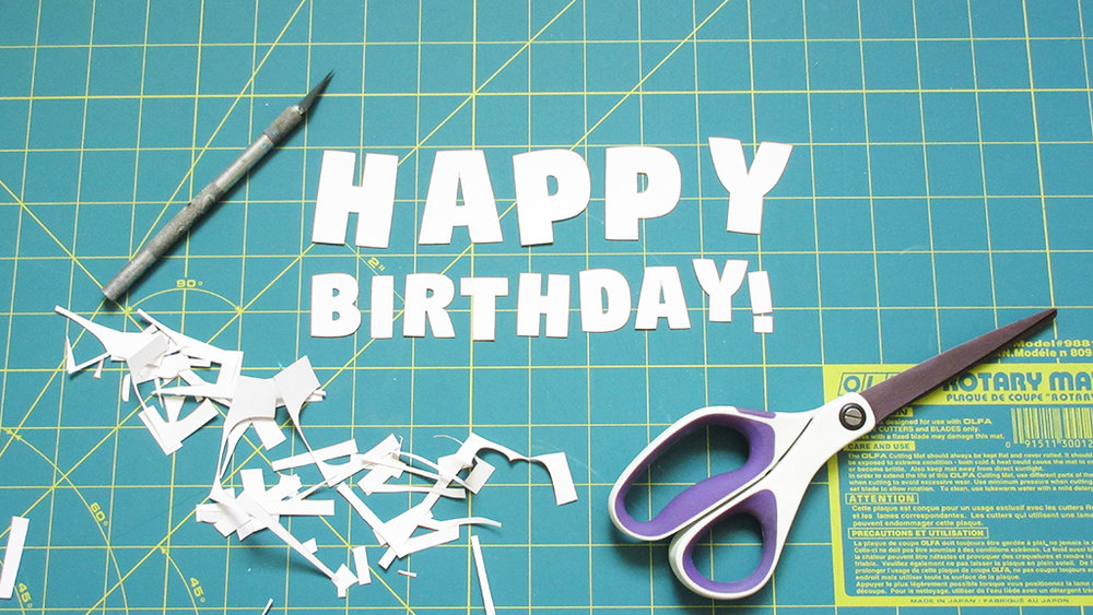 The letters for the DIY Pinata Letters Cake Topper are cut out