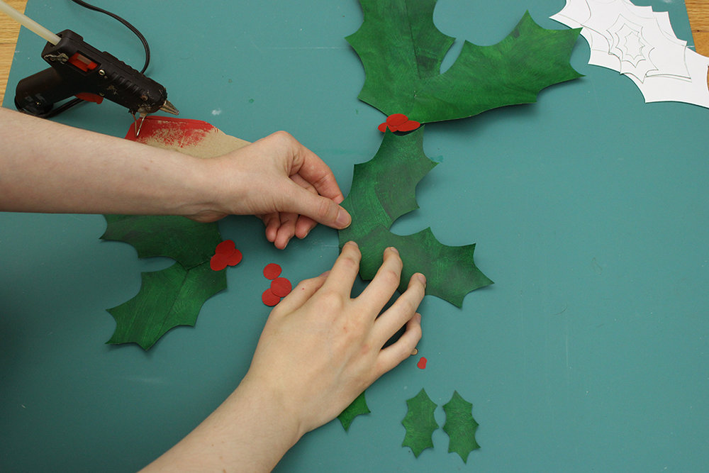 Hot gluing Holly Leaf Decoration together