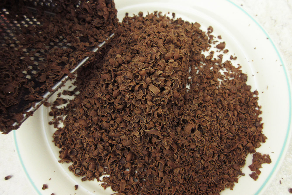 Grated chocolate for DIY Vegan Candy Cane Cocoa Mix