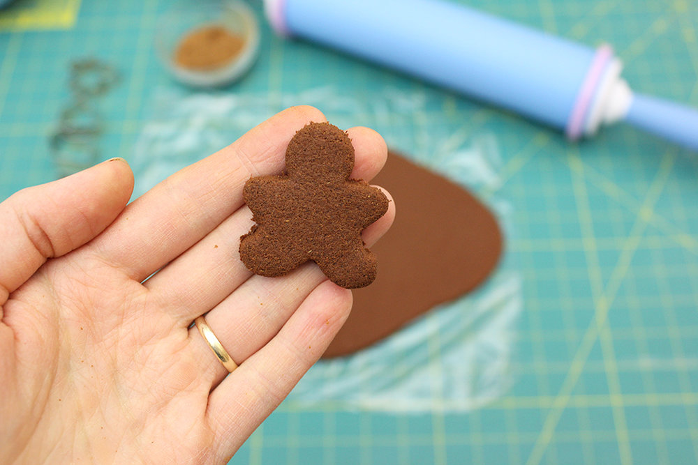 Holding cut out gingerbread man