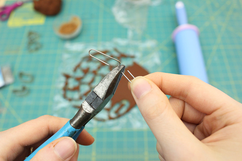 Cutting paper clip with wire cutters