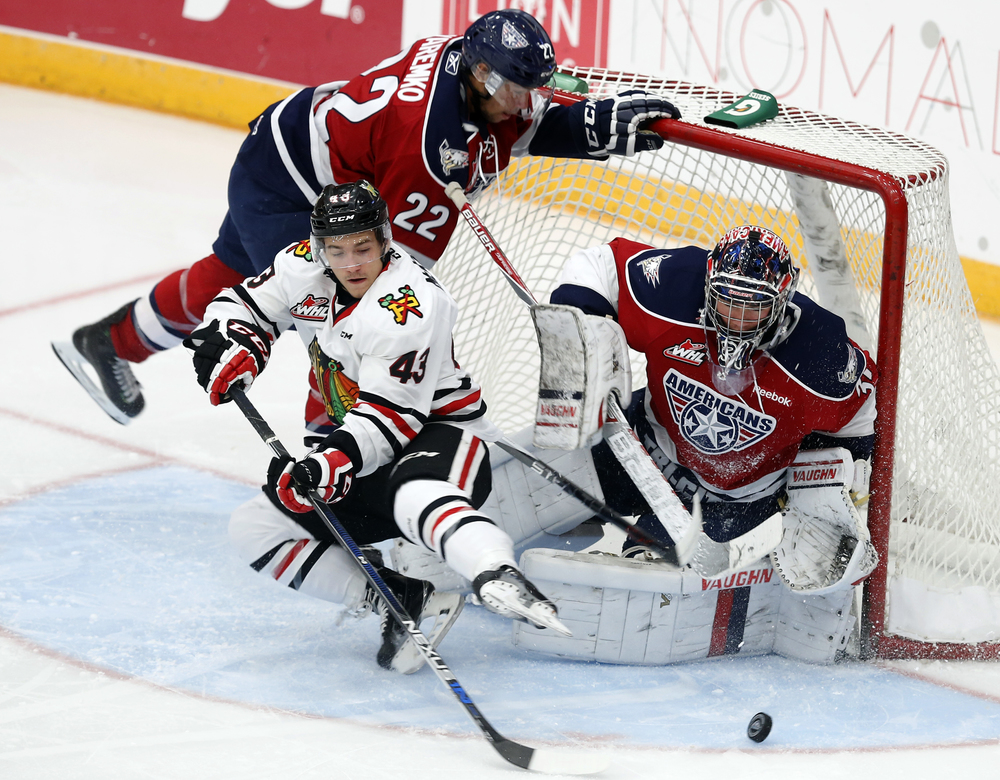Tri City Americans' Ervan Sarthou (31) and Nolan Yaremko (22) block a goal attempt from Portland Winterhawks' Skyler McKenzie (43) October 24, 2015 during a game at the Toyota Center in Kennewick.