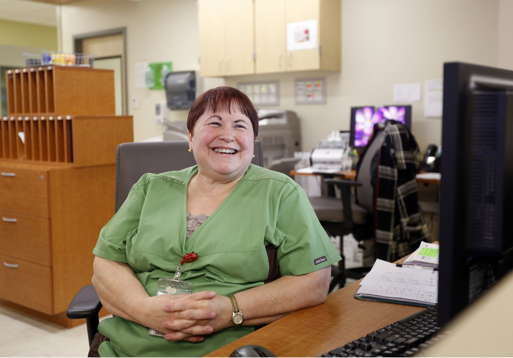 Patsy Haeg, an overnight charge nurse in the emergency department at Trios Southridge Hospital in Kennewick, laughs as she talks with coworkers during the 1 a.m. hour.