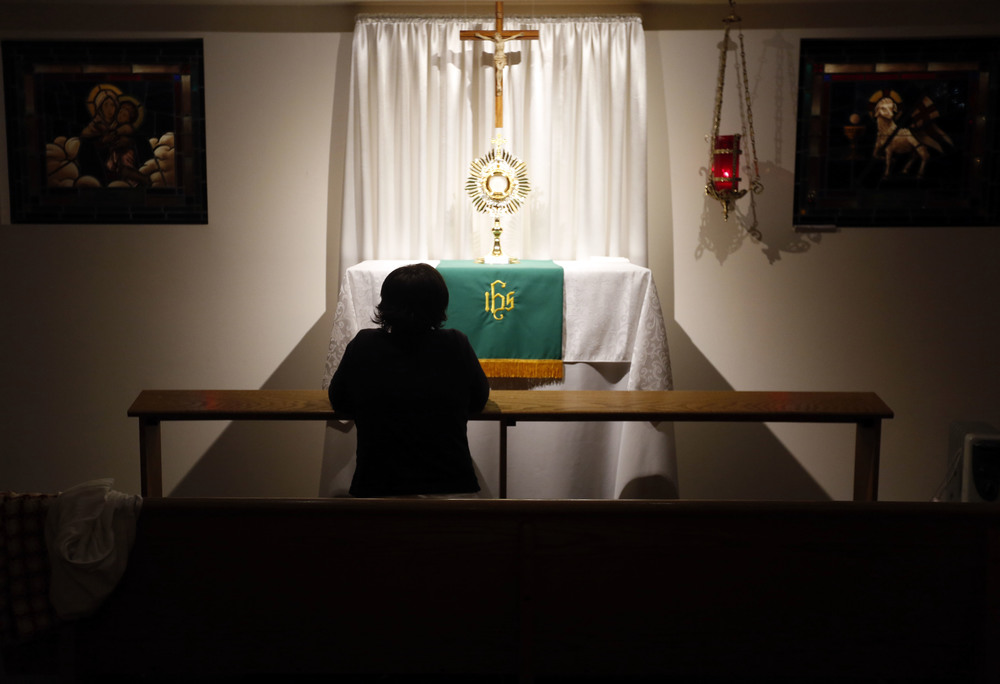 Carol LeCompte, 66, of Kennewick, sits quietly as she prays at the perpetual adoration chapel at St. Joseph Catholic Church in Kennewick during the 2 a.m. hour. LeCompte, who is the coordinator of the program, spends a few early morning hours a week in the chapel.