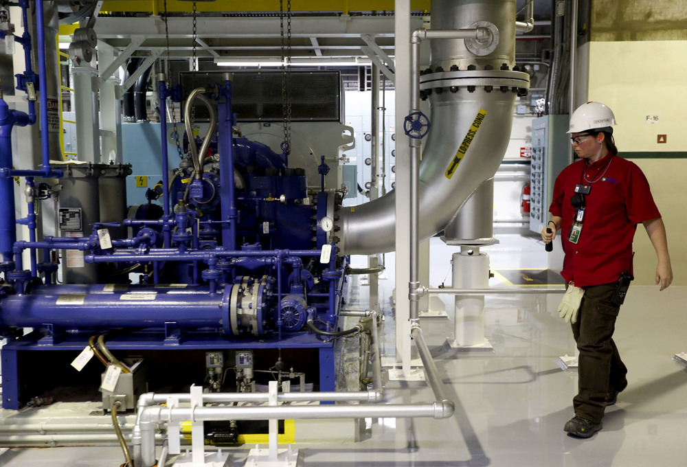 Angela Deahl inspects a piece of equipment during her overnight shift at the Columbia Generating Station near Richland.