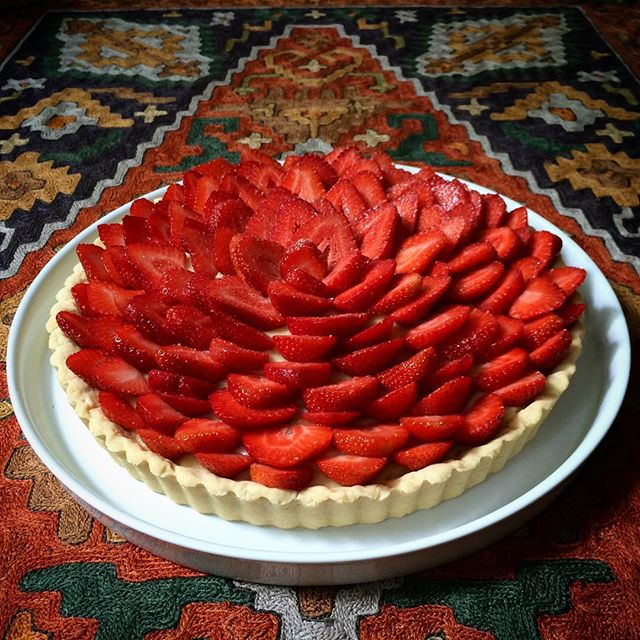 Fresh, local strawberries go well with a sugar pie crust, kirsch pastry cream and a sprinkling of powdered praline.