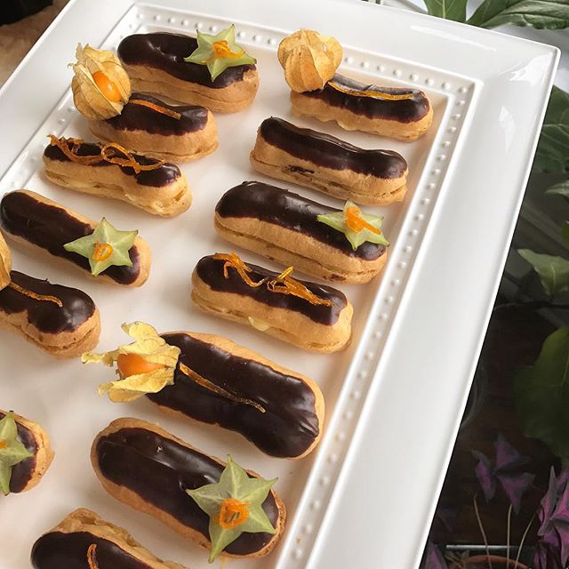 Homemade eclairs filled with orange-rum pastry cream, garnished with chocolate ganache, candied orange peel, star fruit and ground cherries. Nice with for a cold weekend with a hot cup of coffee. #trybaking #followtrybaking #eclairs #cremepatissiere #choclateganache #starfruit #groundcherries #candiedorangepeel #homebaked #bakeathome #homebaker