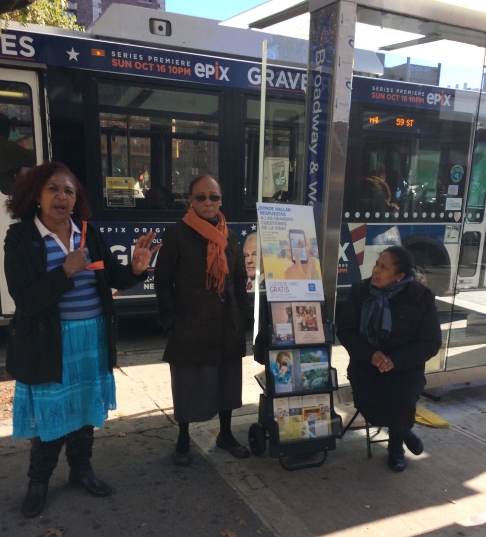 12. Three ladies with JW pamphlets