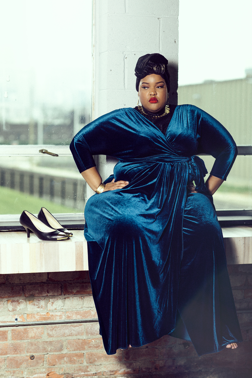 Photo:  Remy Roman     Wrap Dress and Accessories: Peacock Room Detroit