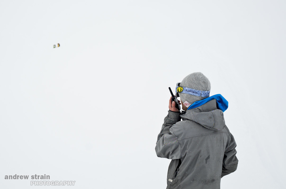 John Swystun tries to give the crew navigation directions in a whiteout along the Spearhead Traverse while filming for the WSSF Intersection competition.