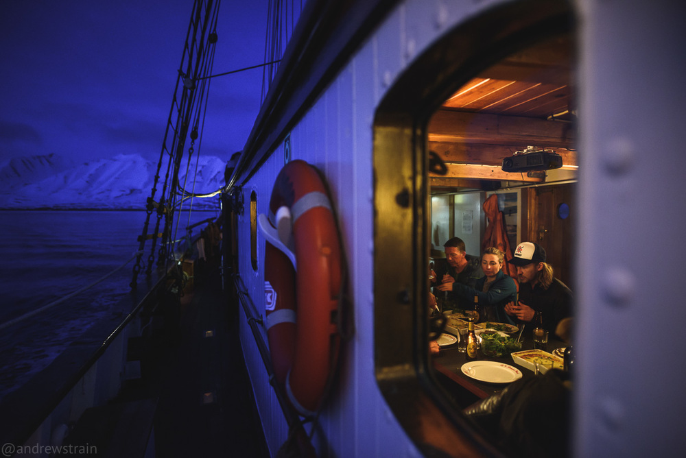 Nikon D810 + Sigma 20mm f/1.4 Art @ f/1.4 | 1/100 sec | ISO 1600 Dinner is served about the Donna Wood, a 98 year old dutch lighthouse ship repurposed as a sailboat by North Sailing. I waited until twilight to capture this perfect balance of the dim tungsten and deep blue ambient.