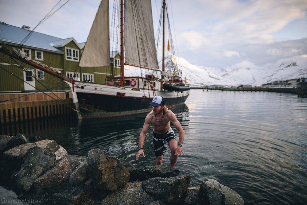 Nikon D810 + Sigma 20mm f/1.4 Art @ f/1.4 | 1/1000 sec | ISO 100 I used continuous autofocus to track Ole-Kristian Strøm as he dashed out of the frigid North Atlantic and into the seaside hot tub of the Sigló Hótel in Siglufjörður, Iceland.
