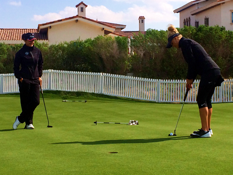 Booth and Boulden got a feel for the Yas Links greens on Friday afternoon