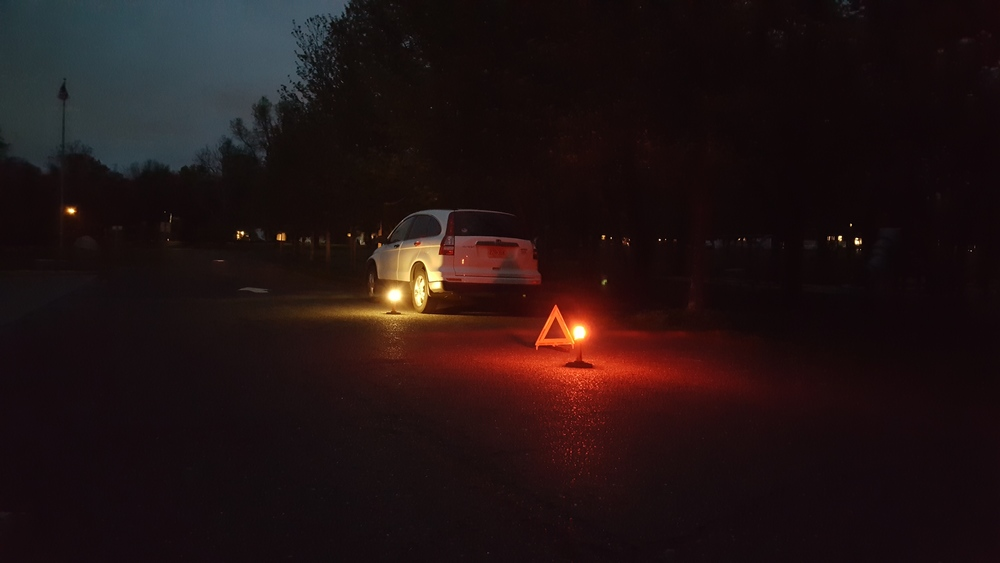 In this photo you are seeing how the EMERGI-SAFE 2020 can be a great addition to the commonly seen reflective triangle. The triangle offers Reactive Warning, the 2020 provides PROACTIVE WARNING!! You are also seeing how the 2020's Work Light (Lantern) function can provide hands free illumination in the event you have to change a tire