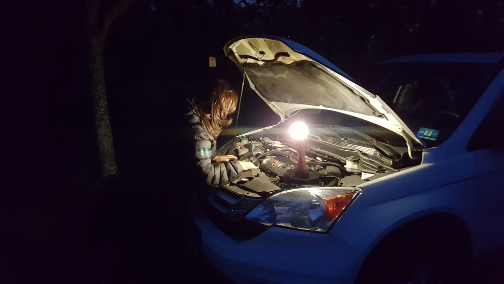 In this photo you are seeing how the EMERGI-SAFE 2020's Work Light (Lantern) function can provide valuable lighting if you should need to check something under the hood