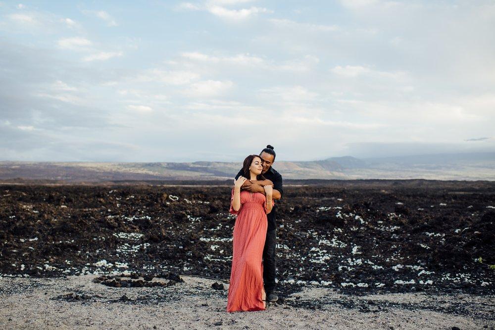 couple embracing on lava rock