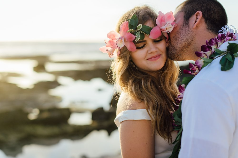 sweetest kiss for a bride from her groom during their hawaii wedding