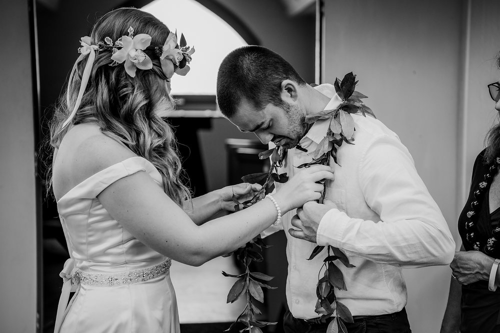 Elopement Hawaii Bride putting on Lei on Groom