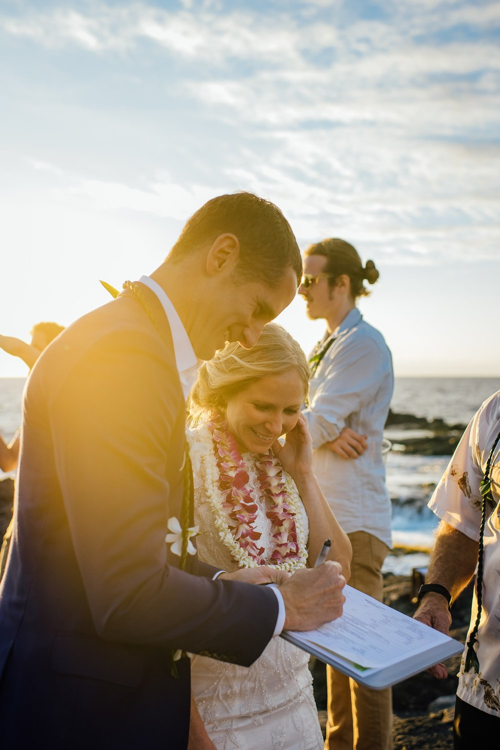 singing marriage certificate pine trees beach wedding