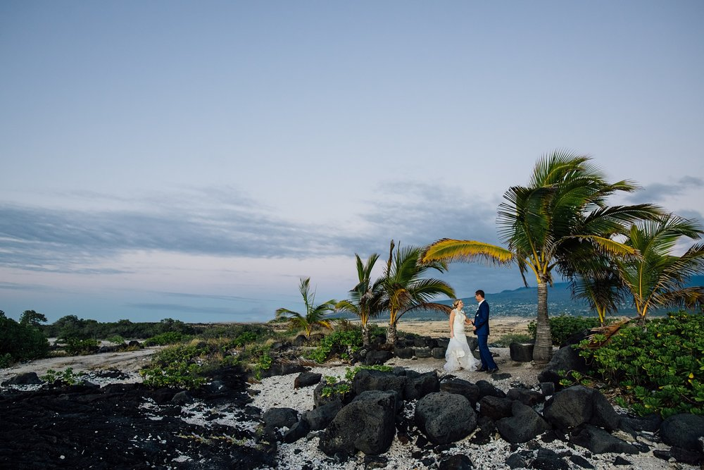 bride and groom against hualalai volcano