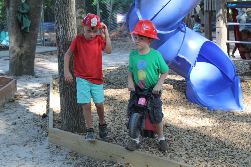 Hats on the playground inspire imaginative play.