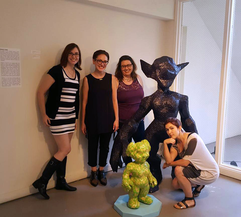 The fabulous women from Not Your Mama's Gamer blog and curator Jessica Segal pose with my Otherkin sculptures, Kryzzik and Niselle.