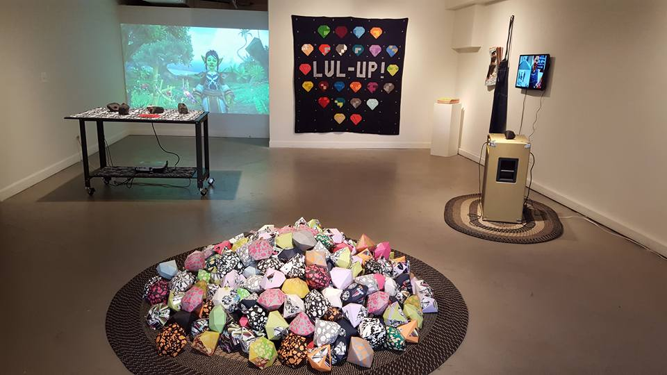 Installation view of   Quest!  , 2016.  Features two installations,   LVL-UP!    (right and foreground) and   Choose Your Own Adventure   (left, background).