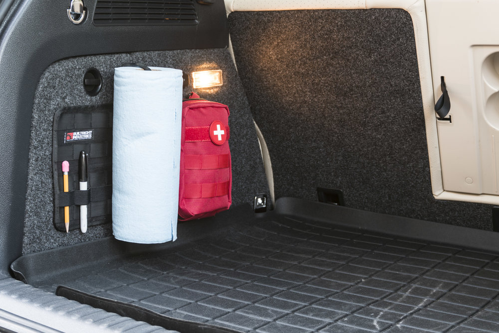 BuiltRight Industries Large Tech Panel in use as a molle velcro panel in the truck of our small SUV. This configuration keeps the cargo floor clear and organized, but keeps some essential items accessible.
