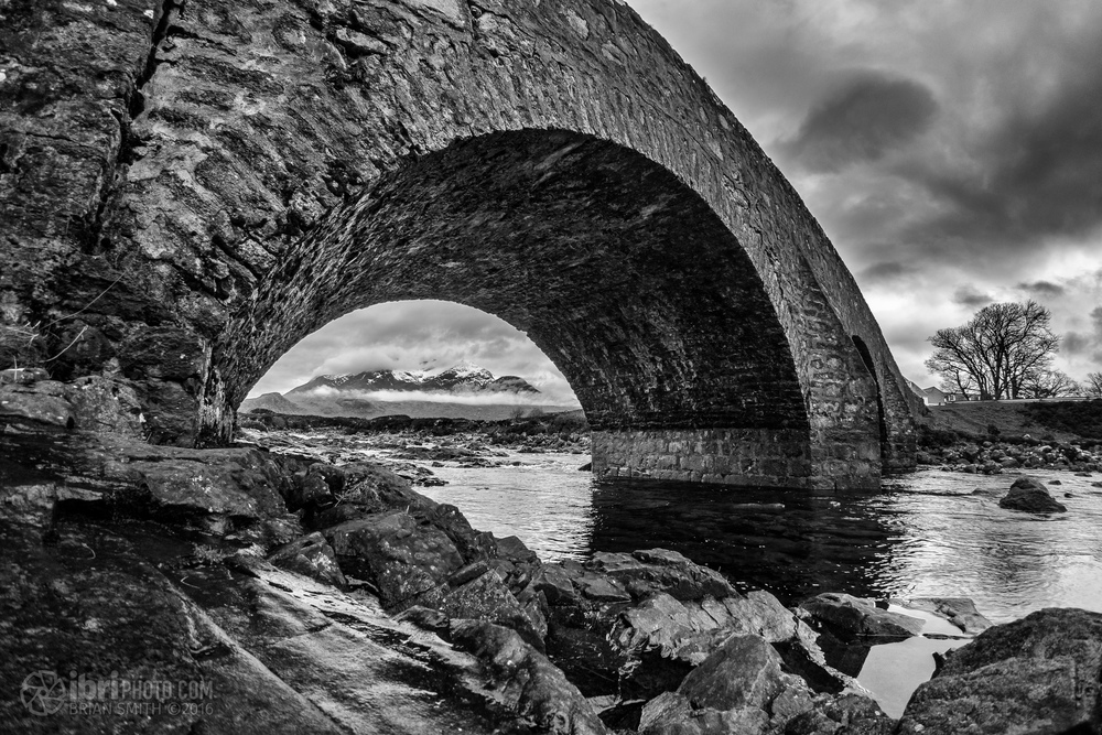 Cloud wasn't for shifting from the tops of the Black Cuillins today, so decided to take a different view of them through an arch of the bridge.