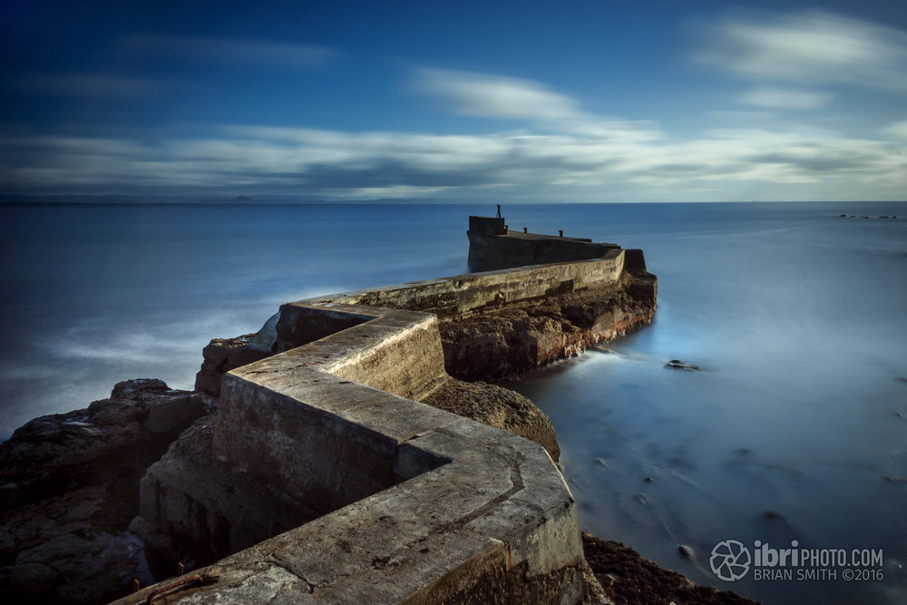 Seems to be a bit of a pilgrimage for photographers this spot - the east pier at St. Monans. Not the best of lighting conditions this afternoon, but in a less harsh light and with some less benign weather I can see why; there's something very appealing about the lightning strike lines of the breakwater as it follows the natural rocks out into the Firth.