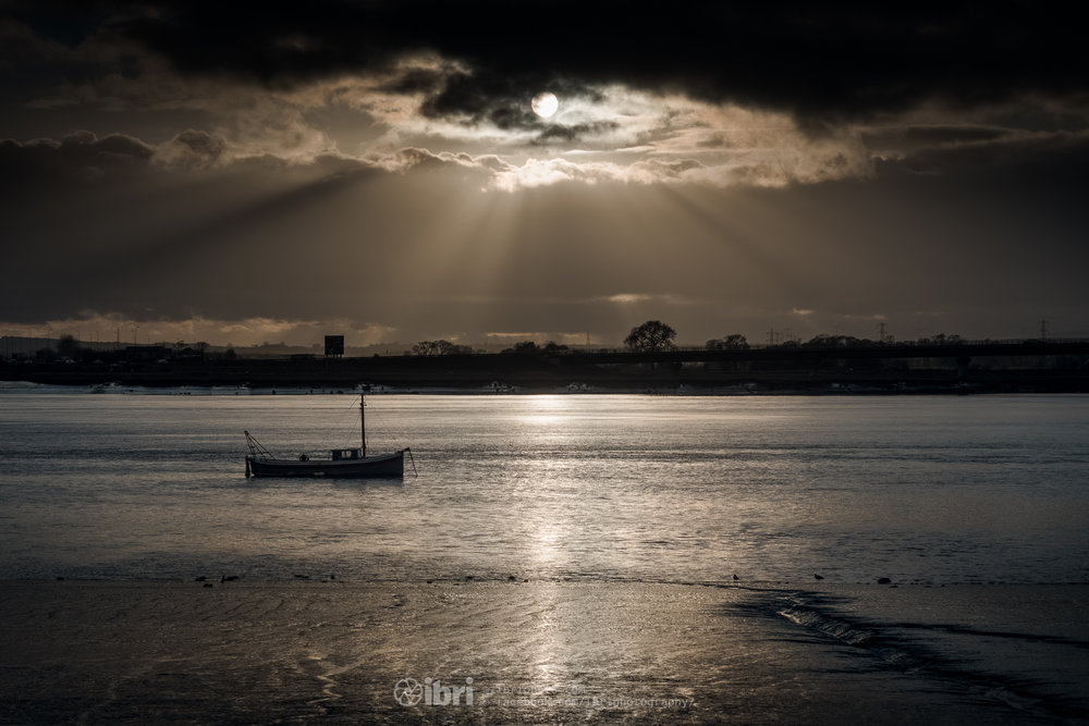A bitterly cold afternoon for a walk between the Kincardine and Clackmannanshire Bridges, despite the sunshine. The tide had turned this boat directly up-river as the sun peeked out below the clouds. Impressed with the dynamic range captured through the camera in this shot.   Shot with my favourite piece of old glass. Sony A6500 - Minolta MD Rokkor 50mm 1:1.7 - 50mm - 1/4000 sec - f11.0. RAW Processed in Lightroom and Photoshop - 2 exposures combined - 0EV & +2EV