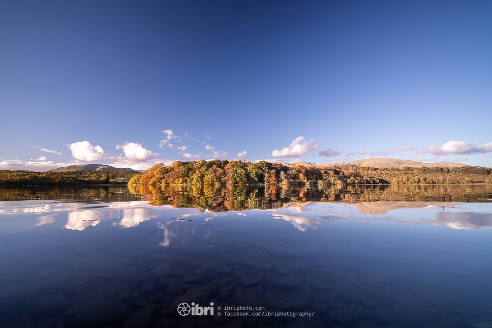 Clear skies and still reflections on Gartmorn Dam.
