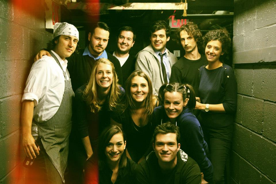 Onassis Backstage at UCB NY, 2013.                                       Left to right: Jason Saenz, Frank Hejl, Dawn Luebbe, Jocelyn DeBoer, Mike Scollins, Lauren Adams, Paul Briganti, Josh Ruben, Kassia Miller, Rob Michael Hugel, Emily Altman.