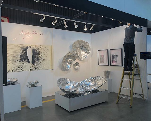 Our booth at the #LAartShow2019 while @made_x_mason adjusts the lights on the Gesture Wall Piece I. Come see us & the work at Booth #906. . Stay tuned to follow the progress of the Show!! . . . . . #laartshow @LAartShow @DesignIsRI #DesignisRI #DesignIsRhodeIsland @designxri #DESIGNxRI @RImonthly @interiordesignmag #interiordesign #homedecor #design #furnituredesign #sculpture #pewter #printmaking #letterpress #metalworking #blacksmith #femaleblacksmith #emergingdesigner #contemporaryart #vessel #wallart #wallsculpture #contemporarydrawing #art+design #WarrenRI #GestureSeries #McKenzieGibson #McKenzieGibsonStudios