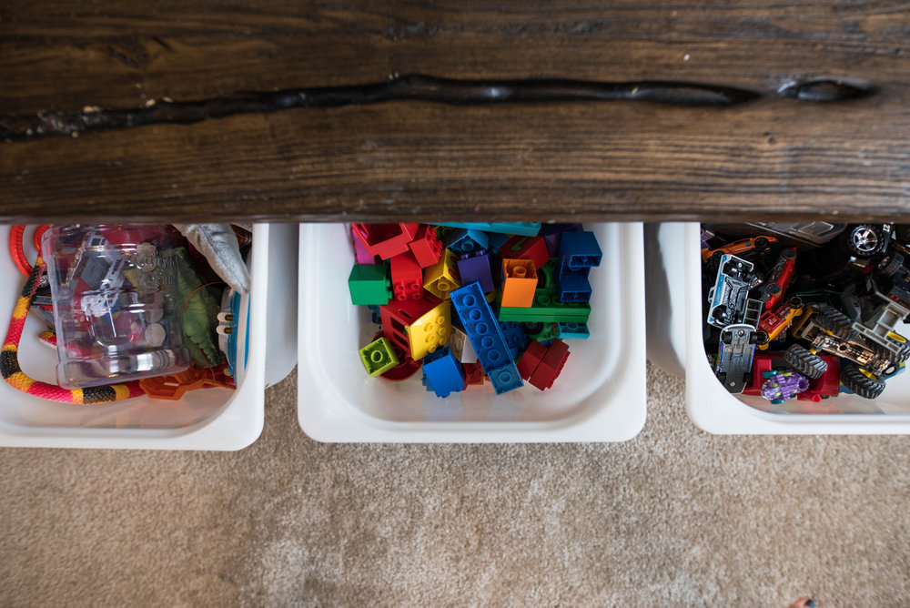Toys that live in the living room belong to these three bins: cars and trucks, legos, and the box full of everything else that doesn't fit any other category.