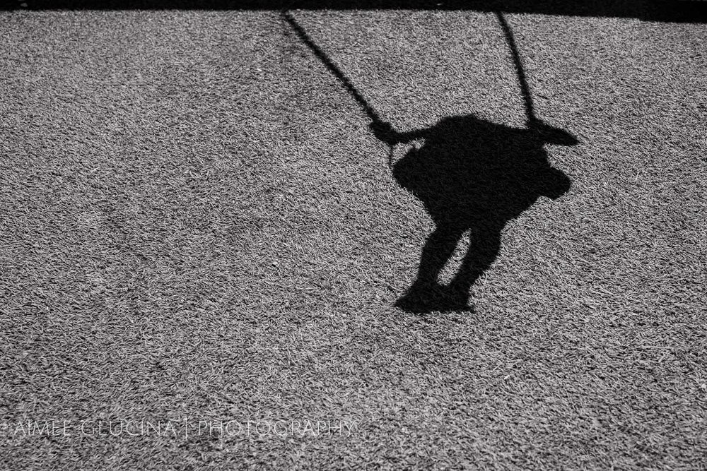 The shadows were more interesting than the busy, chaotic, brightly lit scene I would have got shooting straight on.