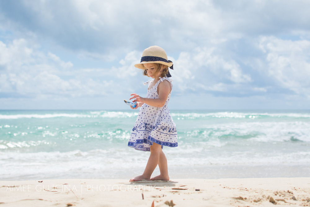 The beach is almost always busy. You have a decision to make, either embrace the chaos and include it all in a wide shot, or isolate your child by shooting straight down from above or from a low angle with the sky as background.