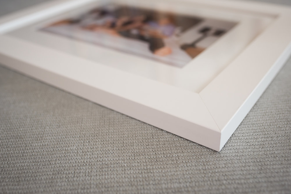 - Modern square frame in white with spanish white mat
